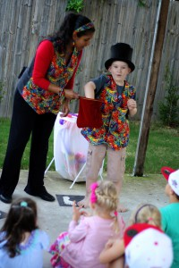 Child magician helping Jazzy J the Magician