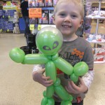 Happy boy receiving a balloon sculpture