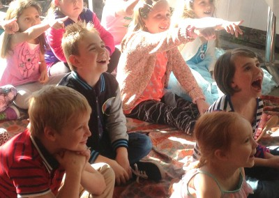 Children laughing at a magic show